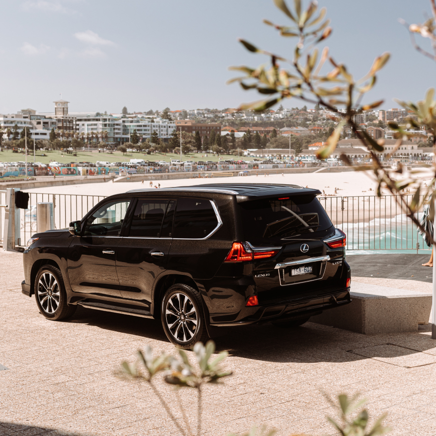 2021 Lexus LX 570 S parked at a beach, facing away.
